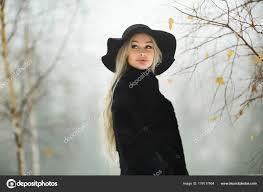 beautiful young girl fur coat hat walking snow park stock photo