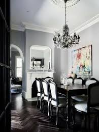 dining dark wood herringbone floor french provincial black and white chairs colourful artwork dining room designkitchen