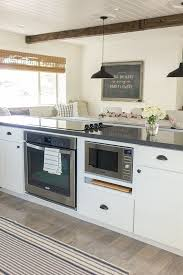 built in stove. I Like How The Seating Is Attached To Counter And Appliances Are Built In. Would Not Put Stove Top Here, Though, Because When Cooking, In