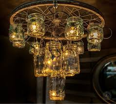 our salvation army finds made into a chandelier very easy to make with an old bike wheel fishing hooks 14 mason jars and a string of lights