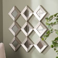 This Upton Home mirrored wall sculpture features nine individual  diamond-shaped mirrors framed in a