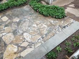 flagstone patio with grass. Once The Area Is Thoroughly Cleaned We Finally Brush And Water In Polymeric Sand Also Called Gator Dust, Leaving A Solid Grout Between Flagstone Patio With Grass