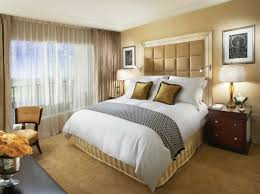 Luxury Bedroom With Beige Bed Frame And Thick White Bedding ...