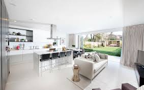 sofa in kitchen. photo of white kitchen living room lounge with breakfast bar and furniture sofa in