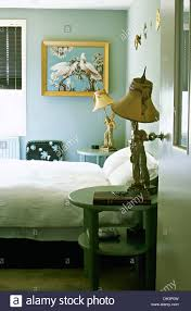 Pale Blue Bedroom Unusual Figurine Lamps On Pale Blue Tables Beside Bed With White