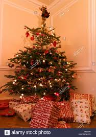 christmas trees decorated professionally with presents. Modren Trees Christmas Tree With Presents And Angel On Top In Lounge For Trees Decorated Professionally A