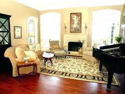 area rug over carpet in living room carpets on ideas t