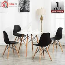 like bug eames kitchen round dining table set with 4 units eames chairs black 1