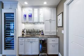 recessed lighting glass shelves wet bar doors glass front top cabinetry large wine fridge recessed panel cabinets recessed panel cabinet under cabinet