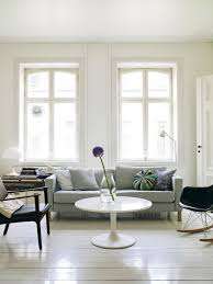 Living Room With White Walls 10 Sneaky Ways To Make A Small Space Look Bigger The Everygirl