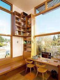 home office lighting. example of a midsized trendy builtin desk medium tone wood floor home office lighting