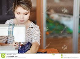 Fashion Designer Part Time Job Young Woman Sewing With Sew Machine At Home While Sitting By