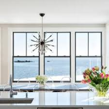 Black Frame Windows In Open Dining Room And Kitchen