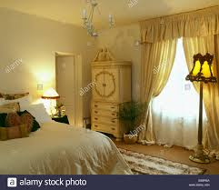 Pale Bedroom White Voile And Yellow Silk Curtains On Window In Pale Yellow