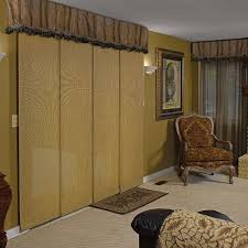 the panel track window shade features sliding fabric panels for sunlight filtration for sliding glass doors large windows or other wide openings