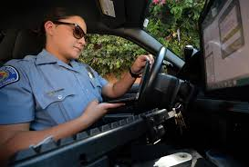 garden grove pd cso summer bogue uses uses a portable device to generate a parking ticket
