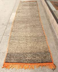 very long hand woven tribal moroccan pile runner rug looks like a wild