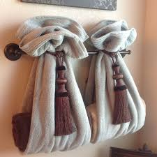 Image Towel Rack Diy Decorative Bath Towel Storage Inspiration Using Two Drapery Tassels Secure Two Towels Over Towel Rack And Add Towels Inside Very Clever Bathroom Pinterest Exclusive Diy Towel Storage Ideas Bathroom Breaks Pinterest