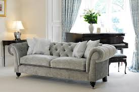 Furniture Grey Fabric Chesterfield Sofa With Four Pillows Table Fabric Chesterfield Sofas Uk