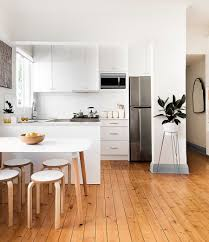 White Kitchen With Hardwood Floors Wooden Island Indoor Planters Scandinavian White Cabinets 3 Bar