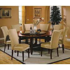 attractive rectangle area rug beneath armless upholstered chairs and 72 inch round wooden dining table