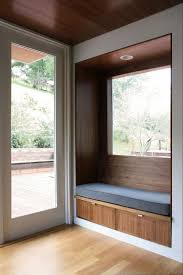 I love the idea of this little wooden bench seat being built into a wall,. Modern  Window ...