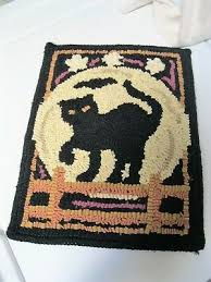 primitive wool hooked rug wall hanging black cat on fence