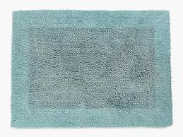 zara s cotton bath mat is reversible meaning you could get twice the use out of it before tossing in the washing machine do mind what type of floor you