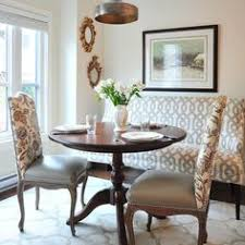 idea for upholstered dining chairs to tie in original table w new decor