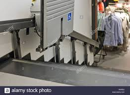 chair lift elderly. Chair Lift For Disabled And Elderly People To Climb Stairs In A Clothing Store. -