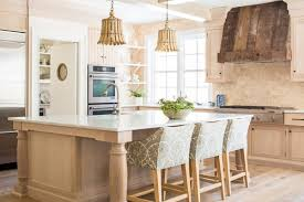 the fruitier pendant by currey and co has the classic wood finish this goes back to the epitome of how we think tropical lighting should look