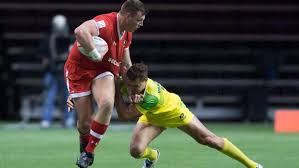 canada s adam zaruba left fights off australia s stephan van der walt during world rugby sevens series canada sevens tournament action in vancouver on