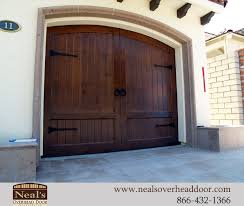 please enjoy this sampling of our custom tuscan style garage doors after you have had a chance to view them please feel free to call us with any questions
