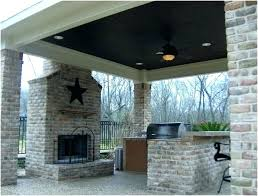 cost of outdoor fireplace comes in new model also covered patio with low co how to build a stone outdoor fireplace cost