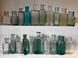 twenty vintage assorted small plain aqua clear glass bottles