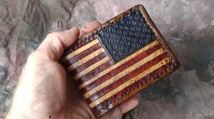it all starts out with a wallet back sized piece of 3 4 oz vegetable tanned cowhide i cover the back with ng tape to keep the leather piece from