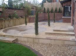 Small Picture Beige Riven Sandstone Paving and Stone Circle in a private garden