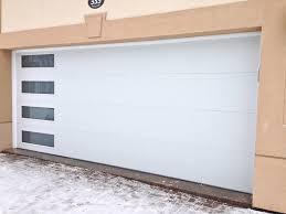 modern white garage door with side lites installed in midland