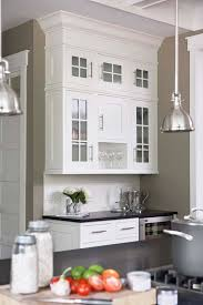 cabinet color is sherwin williams pure white wall color is benjamin moore berkshire beige