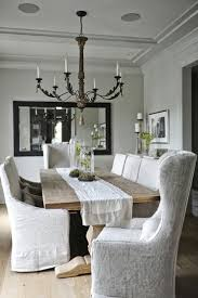 amazing gallery of interior design and decorating ideas of linen slipcovered dining chair in kitchens dining rooms by elite interior designers
