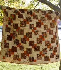 Disappearing Nine Patch Tutorial - The English Geek & Dis 9 patch quilt Adamdwight.com