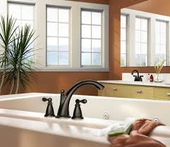 moen 86440srn spot resist brushed nickel deck mounted roman tub filler trim from the caldwell collection valve included faucet com