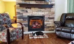 heat n glo 8000 clx and brand new hearth we closed in the wall on the second side of the fireplace and finished with a stacked stone surround topped