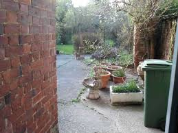 i am advising my friend who has a victorian town house with concrete back patio leading to the rest of the garden we both know that a proper patio would be