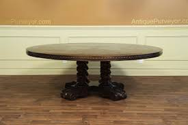large round solid oak casual dining table with robust base