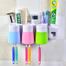 get quotations creative wall suction toothbrush holder tumbler cup suction wall rack automatic toothpaste dispenser with a cup