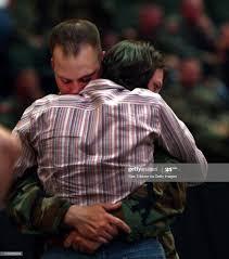 Lori Nathe of Plymouth hugs husband Scott Nathe good-bye as he ...