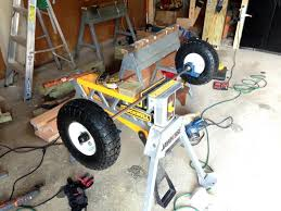 assembling the wheels when building a utility cart for the riding mower