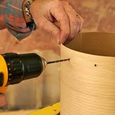 drill holes in the wood veneer