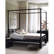How To Decorate With A Four Poster Bed Photos Architectural Digest ...  Modern Contemporary Poster Queen Size Bed Frame Under Rounded Four Made Of  Wooden In ...